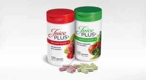 Red and White bottle and green and white bottle of Juice Plus+.