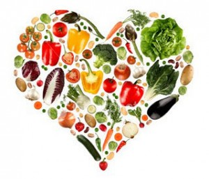 Picture of heart shape with fruits and vegetables.