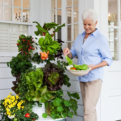 woman enjoying her tower garden